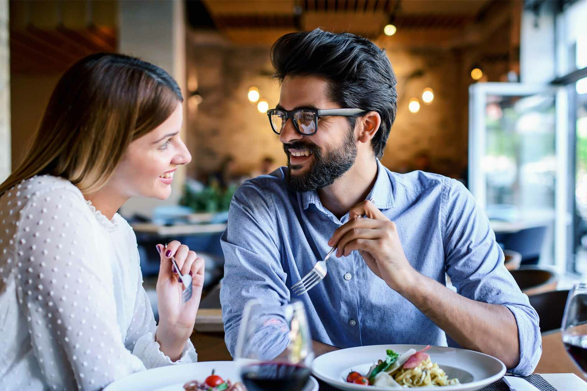 Couple Leans in Over Dinner - Decoding Body Language
