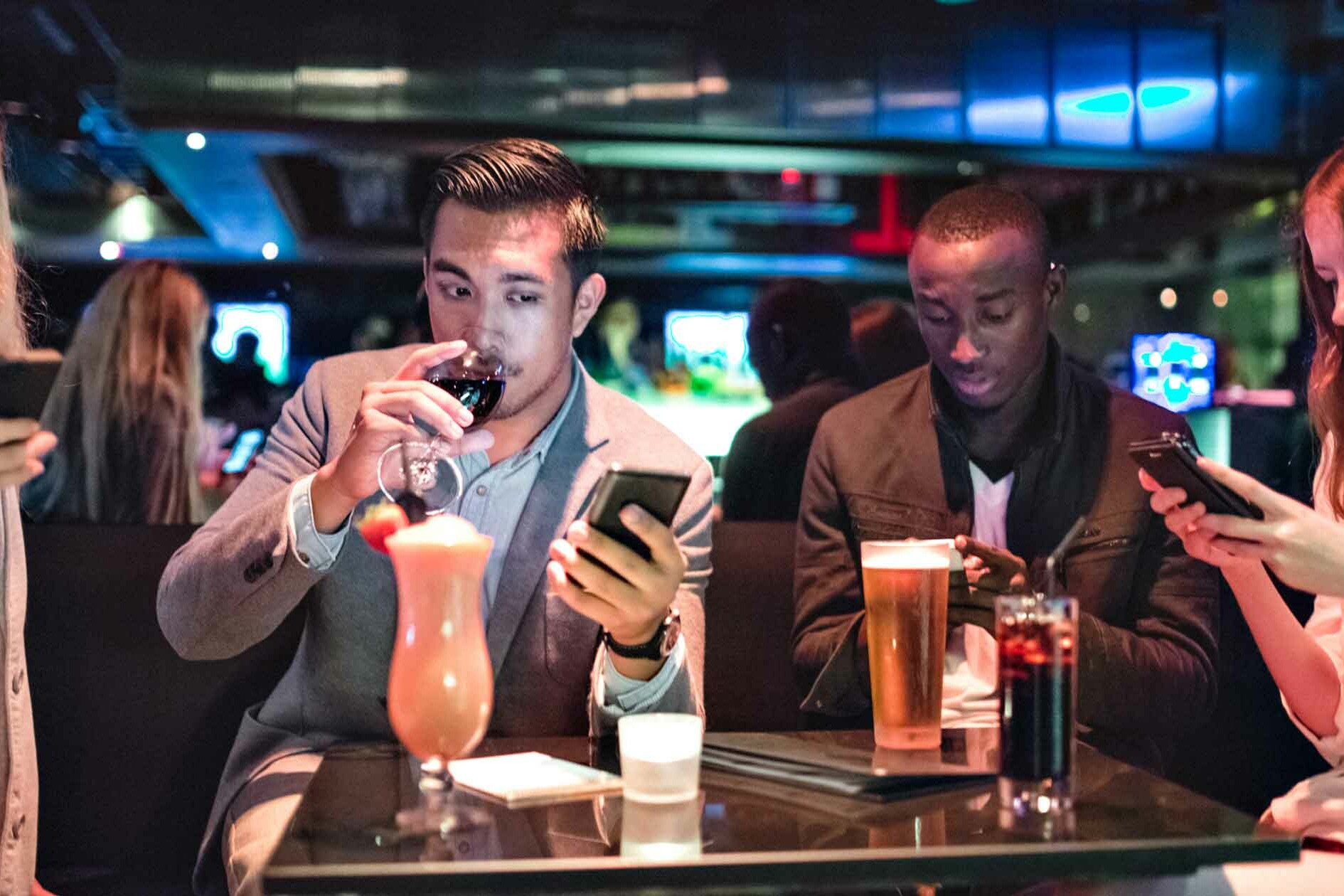 Group of Friends Online Dating in a Bar
