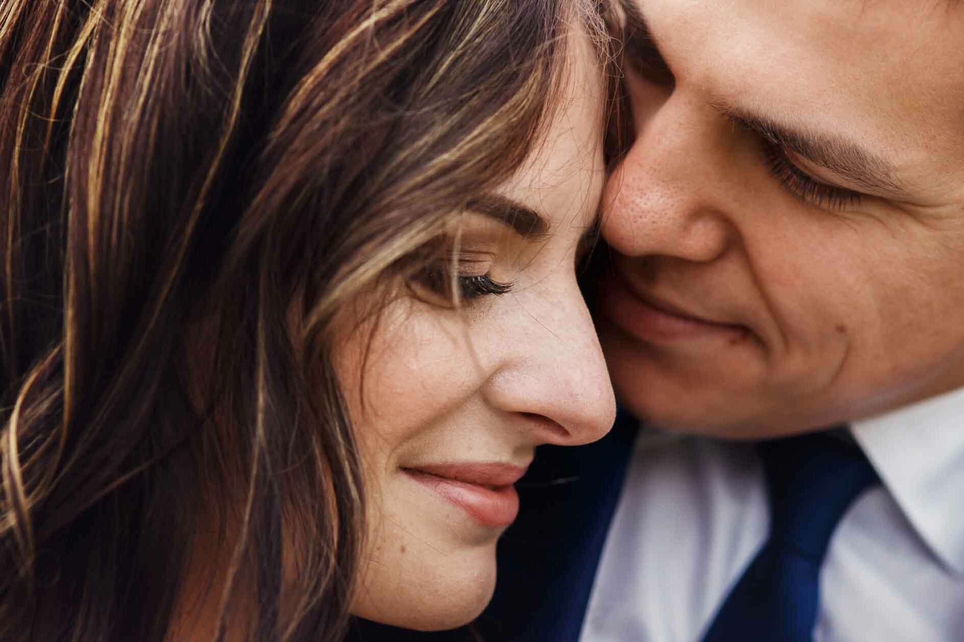 Man in Suit Cuddles Woman - Keep romance Alive